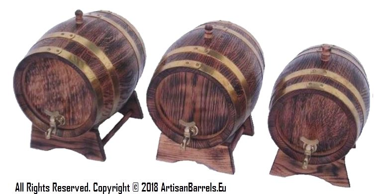 Small oak barrels with brass hoops and taps